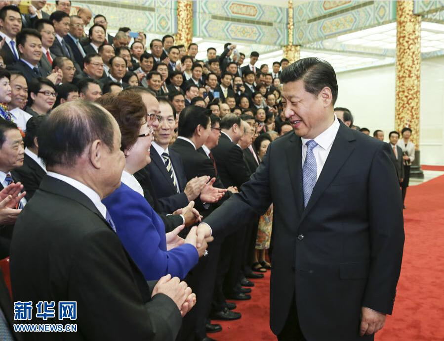 习近平在北京会见第七届世界华侨华人社团联谊大会代表